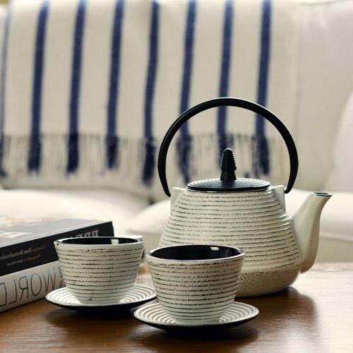 white cast iron teapot and cups traditional